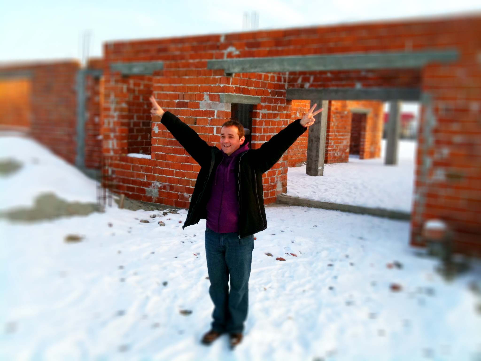 Ovidiu in front of the House of Joy. Construction will start again in the spring.